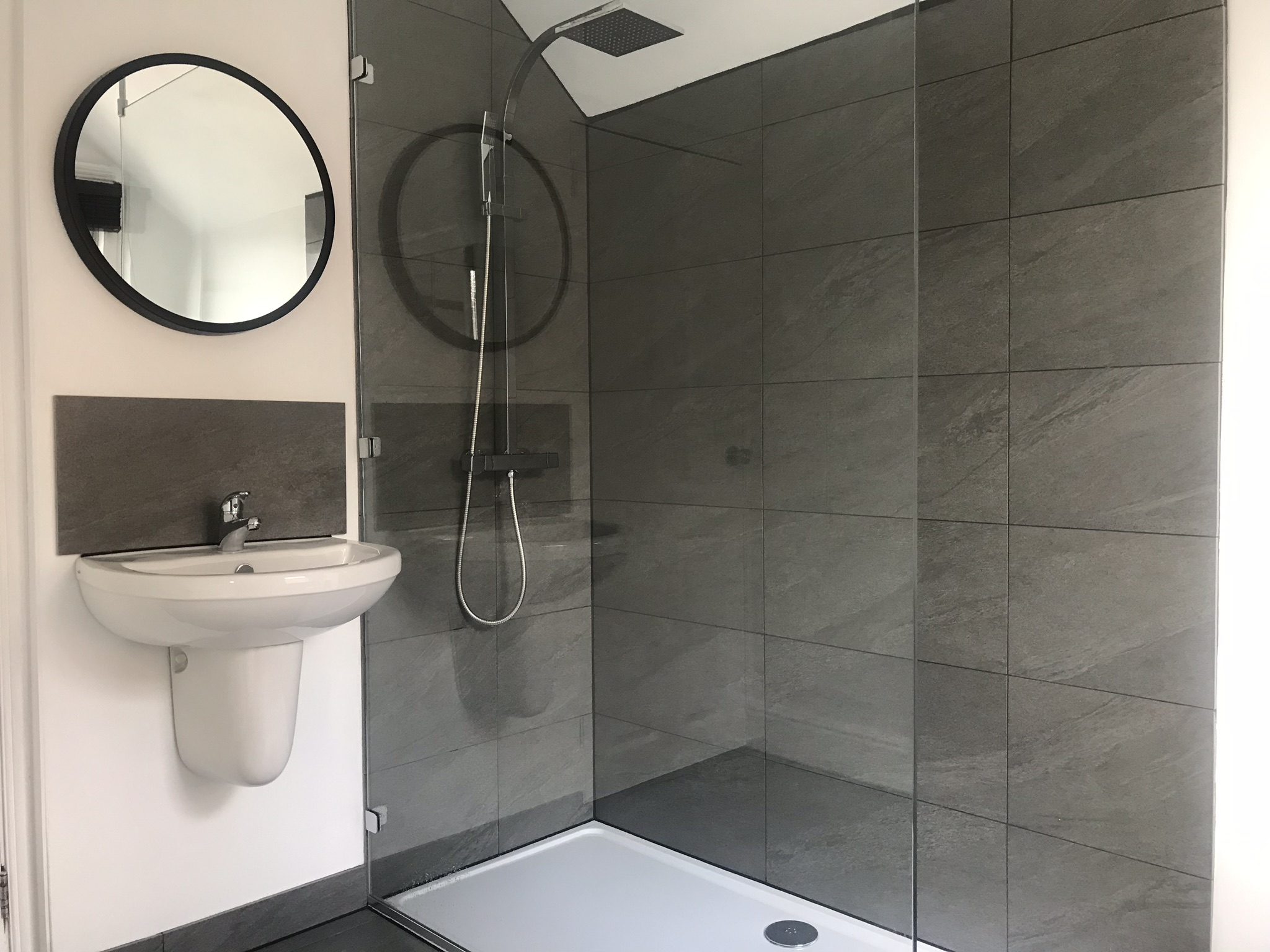 A modern bathroom shower suite in Student Homes Derby student housing